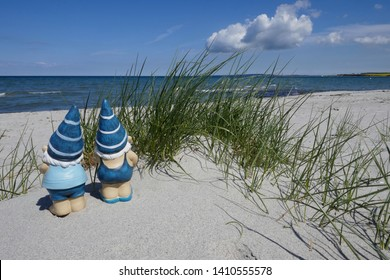 Holidays by the sea ... Dunes, white sandy beach and two gnomes on the Baltic Sea, (not copyrighted) on Sehlendorfer beach in Schleswig-Holstein, Germany, Europe