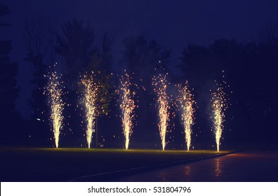 Holidays, celebration concept - many fireworks on ground over evening sky background