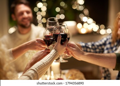 holidays, celebration and people concept - happy friends having christmas dinner at home drinking non-alcoholic red wine - Shutterstock ID 1794356890