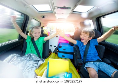 Holidays - Children relax in the car during a long car journey