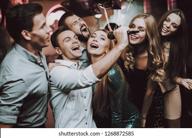 Holidays Concept. Dancing People. Great Mood. Young People. Dance Club. Sing. Microphone. Trendy Modern Nightclub. Party Maker. Birthday. Karaoke Club. Celebration. Men. White Shirt.