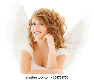 holidays and costumes concept - happy teenage angel girl