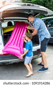 Holidays - Father and son are packing car for vacation