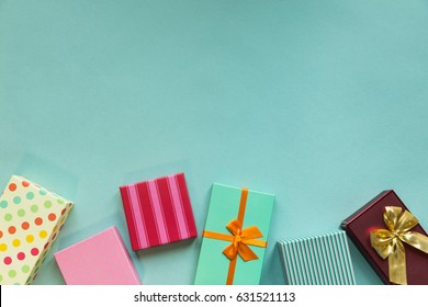 Holidays giftboxes on the pastel mint background for mother's day, christmas, birthday