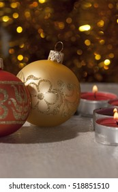 holidays gold background ornament ball and candles
