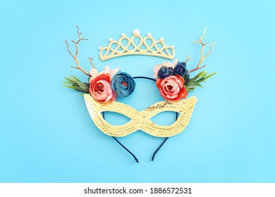Holidays image of mardi gras masquarade venetian mask over blue background. view from above