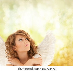 holidays, love and costumes concept - unhappy teenage angel girl
