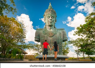 Holidays loving couple on the island of Bali, Indonesia / Garuda Wisnu Kencana at Uluwatu, Bali Island / Bali, Indonesia