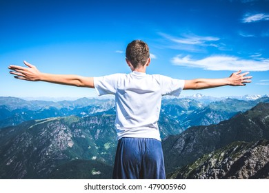 holidays in mountain - boy contemplate the view