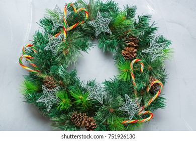 Holidays new year concept. Advent christmas door wreath with festive decoration on a cozy background. Flat lay top view