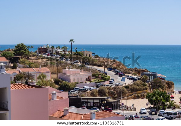 Holidays in Portugal, a Portuguese resort Portimao in the Algarve, blue sky, sea and cliffs
