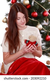 holidays, presents, christmas, x-mas concept - happy girl over Christmas tree/Studio portrait of attractive smiley young woman on Holiday theme