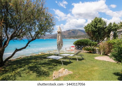 Holidays in Sardinia, Italy. View of sandy beach and sea with azure turquoise crystal clear water, mountains in the background, near Villasimius, Cagliary region. The best beaches in Sardinia.