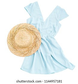 Holidays summer concept. Straw hat and blue clothing on white background. Flat lay, top view.