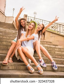 Holidays and tourism, friends, hen party, three beautiful women in the city