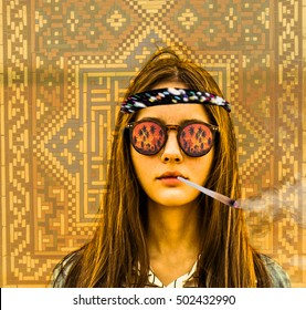 holidays, travel, vacation happiness concept. woman in sunglasses with reflection. palm trees against sun set sky, water. Young hippie girl smoke marijuana against  mosaic wall on background
