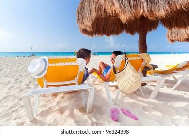 Holidays under parasol at Caribbean Sea