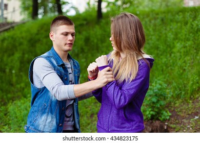 holidays, vacation, love and friendship concept - smiling teen couple young cheerful hipster Best Friends boy and girl having fun, played outdoors, mimic fight, positive emotions, facial expressions