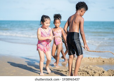 holidays vacations family on the beach, little kid playing with friends, happiness cheerful enjoy on beach