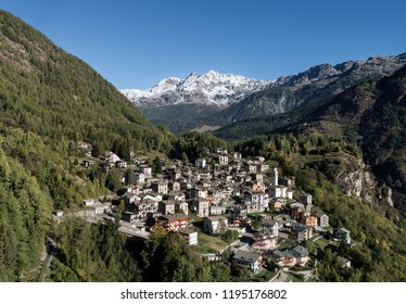 Holidays in Valtellina. Typical village in mountain with forest and high peaks