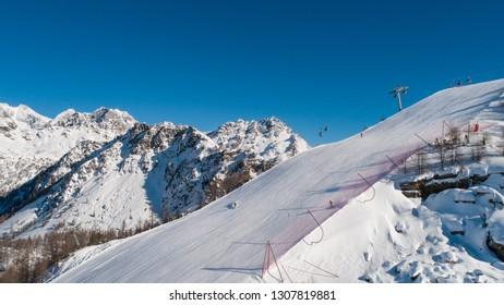 Holidays in Valtellina, Valmalenco ski resort. Skiers on the ski slope