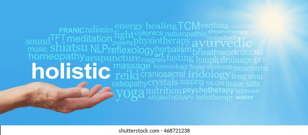 Holistic Therapy Blue Sky Word Cloud -  Female  hand held palm up the word HOLISTIC in white above surrounded by a relevant word cloud on a wide blue sky and bright sunburst background