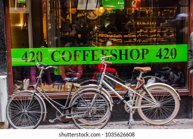 Holland, Amsterdam, February 2018. Coffee shop window with parked bikes