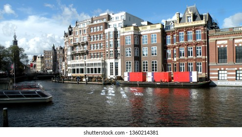 Holland / Amsterdam – October 17, 2009: the canals of Amsterdam, capital of the Netherlands, are navigable and lined with picturesque views of palaces and boats that are reflected in the waters.