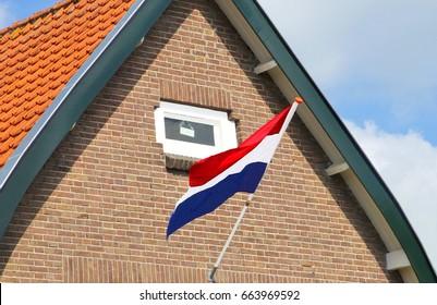 Holland flag at a traditional Dutch house, Koningsdag and Liberation Day (Bevrijdingsdag), Netherlands