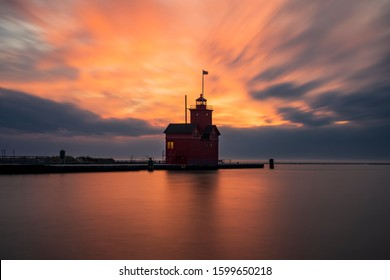 """Holland, Michigan: Holland Harbor Lighthouse stands at the entrance of a channel connecting Lake Michigan and Lake Macatawa. Built in 1907, it is commonly referred to as """"the Big Red."""""""