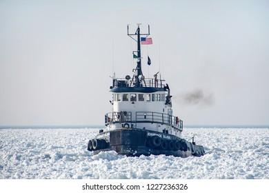 HOLLAND, MICHIGAN - JANUARY 20: Candace Elise tugboat in frozen Lake Michigan harbor, January 20, 2018 in Holland, Michigan