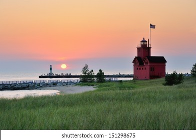 Holland Michigan Lighthouse sunset . Also known as Big Red.
