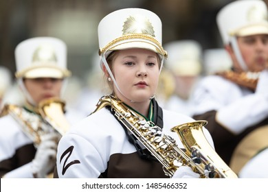 Holland, Michigan, USA - May 11, 2019: Tulip Time Parade, Members of the Zeeland High School Marching Band performing at the parade