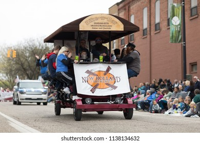 Holland, Michigan, USA - May 12, 2018 A Bike-n-Bar from new Holland Brewing going down the road at the Muziek Parade, during the Tulip Time Festival