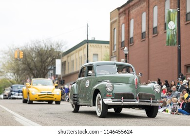 Holland, Michigan, USA - May 12, 2018 A green Studebaker Skyway Land Cruiser 1941 goes down the road at the Muziek Parade, during the Tulip Time Festival