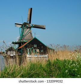 Holland old mill in countryside