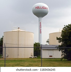 Holliday, Texas / USA - July 27 2009: Pedesphere Elevated Water Tower and a Ground Supported Flat Bottom Tank in a road side view.