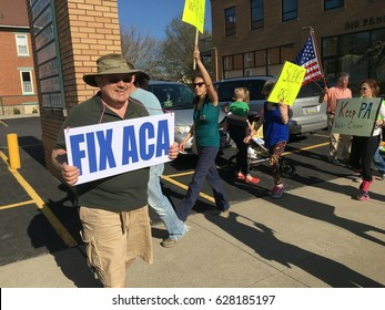HOLLIDAYSBURG, PENNSYLVANIA - APRIL 11: Protesters against President Donald Trump march outside the office of Congressman Bill Shuster on April 11th of 2017.