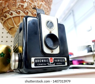 Hollister,CA USA May 19, 2019 A photo of an antique camera made by Kodak called the Kodak Brownie  Hawkeye camera sitting on a shelf in a thrift store.