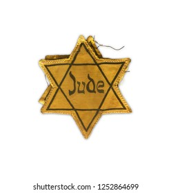 Hollocaust remembrance day, yellow star on white background. The word Jude means Jew in German.