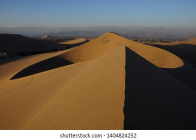 Hollow between dunes formed by the wind in the desert of Huacachina in Ica-PERU