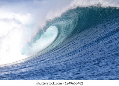 The hollow, covered portion of a wave forming a tube