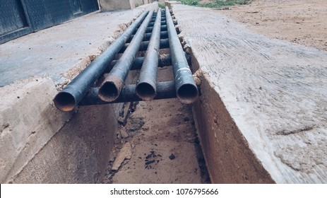 Hollow iron pipes on a drainage