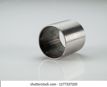Hollow metallic cylinder isolated on white background