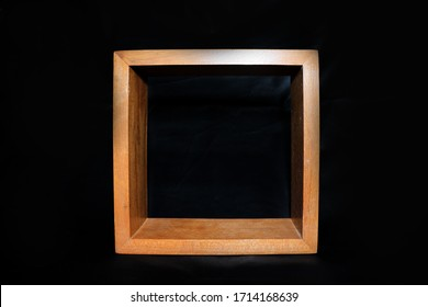 hollow wooden box with a black background