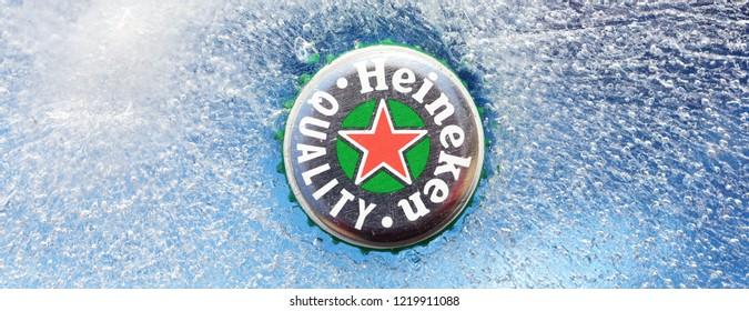 HOLLUM, AMELAND, HOLLAND - February 2, 2018.: Beer cap from Heineken Beer on ice background , Heineken was first brewed by Gerard Adriaan Heineken in 1873