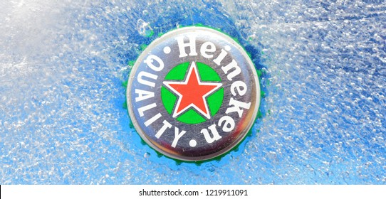HOLLUM, AMELAND, HOLLAND - February 2, 2018.: Beer cap from Heineken Beer on ice background , Heineken was first brewed by Gerard Adriaan Heineken in 1873