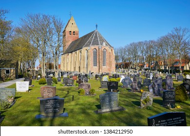 Hollum, Ameland / the Netherlands - April 16th 2019: Dutch Reformed Church Hollum from the 16th century with cemetery