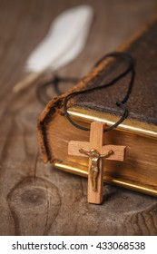 holly Bible and christian cross