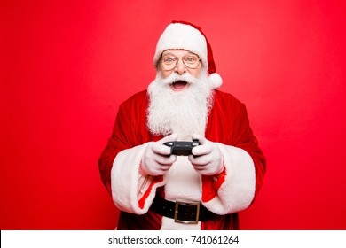 Holly jolly x mas festive noel carefree, chill, entertainment, leisure, tradition time! Funny santa in headwear, costume, black belt, white gloves playing videogames on tv, winning crazy car race